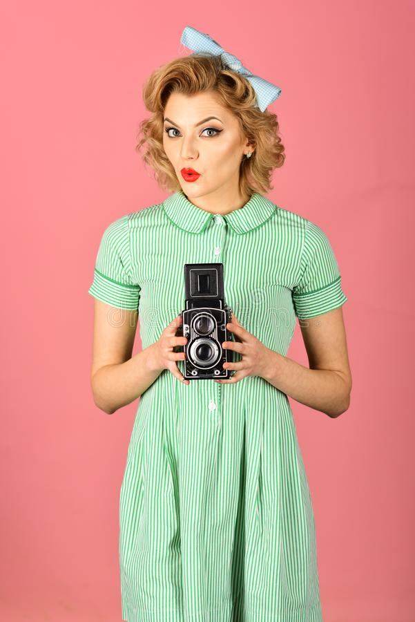 Beauty, fashion photography, vintage style. Sensual girl in pinup style, make photo. Retro woman hold photo camera. Family portrait, old fashion, journalism stock photography