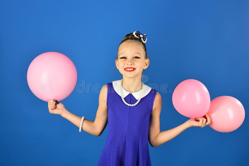 Beauty and fashion, punchy pastels. Kid with balloons, birthday. Small girl child with party balloons, celebration. Birthday, happiness, childhood, look stock photography