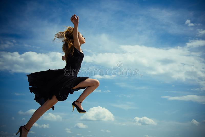 Beauty and fashion style. Free and happy. Future success. Girl on blue sky. Woman with fashion look. Joyful cute girl royalty free stock photography