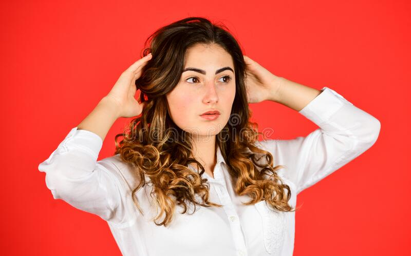Beauty and fashion. Woman satisfied hairdo. Hairdresser salon. Perfect look. Natural curls. Natural wavy hair texture royalty free stock images