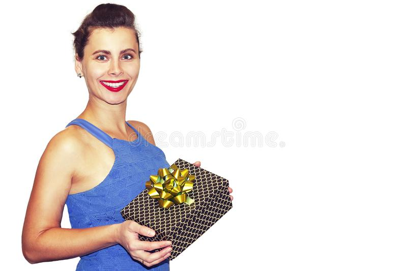 Beauty fashion young woman with gift box in hands on white background. Portrait of girl holding Christmas gifts. royalty free stock image