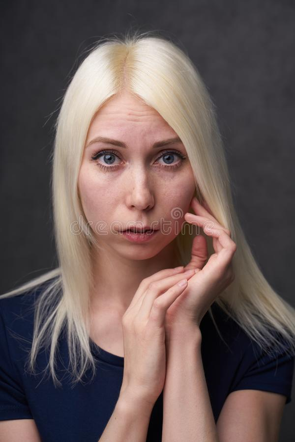Beauty female blond in black casual clothes on gray background. Portrait royalty free stock photos
