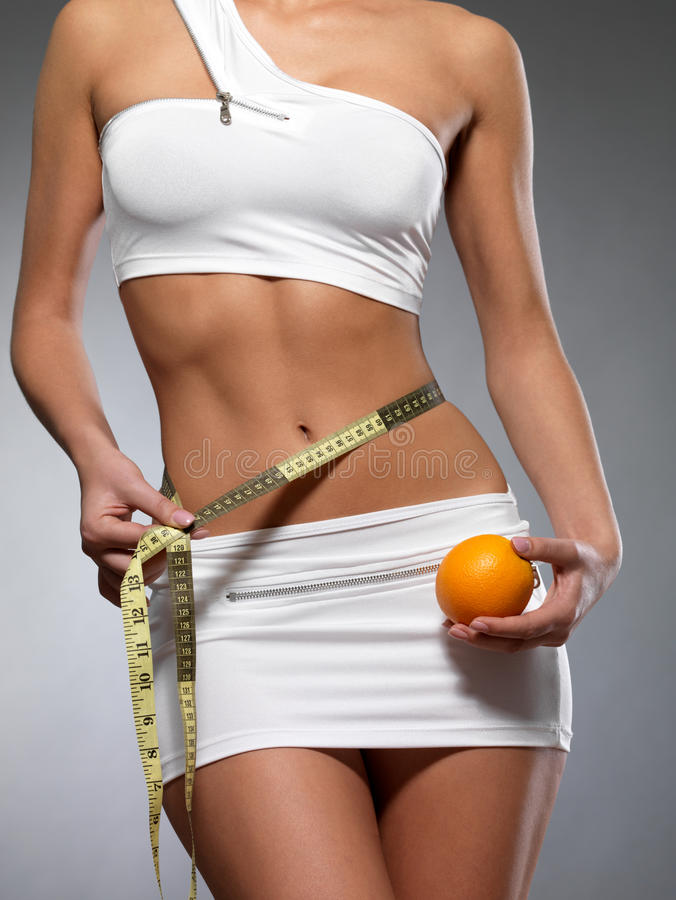 Free Beauty Female Body With Measuring Tape And Orange Royalty Free Stock Photo - 27654955