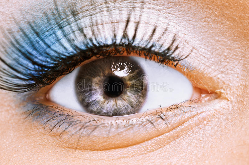 Beauty female eye with blue make. Front view of beauty female eye with blue make up it is large stock photo