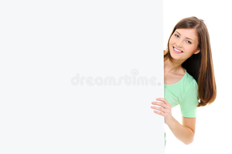 Beauty female look out from the big blank banner stock images