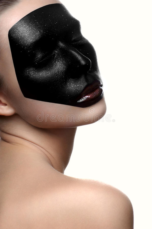 Beauty female model with dark face and closed eyes. Fashion beauty female model with dark face and closed eyes royalty free stock image