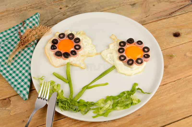 Beauty flowers food. Fried egg in the shape of fancy flowers, kid food stock image