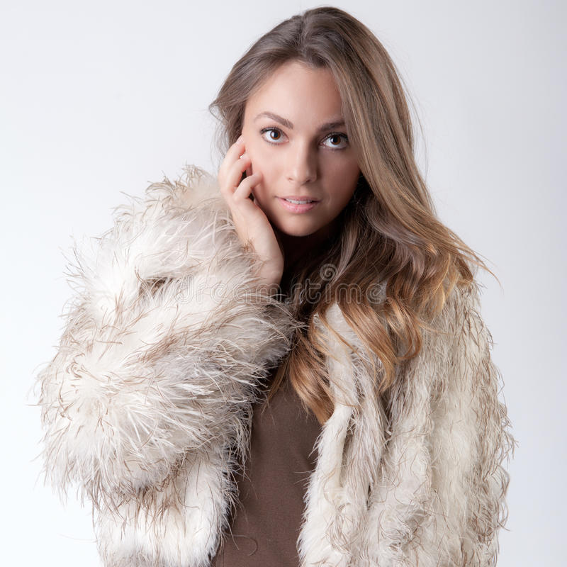 Beauty in Fur. A portrait of a stunning woman in a fur coat stock photography