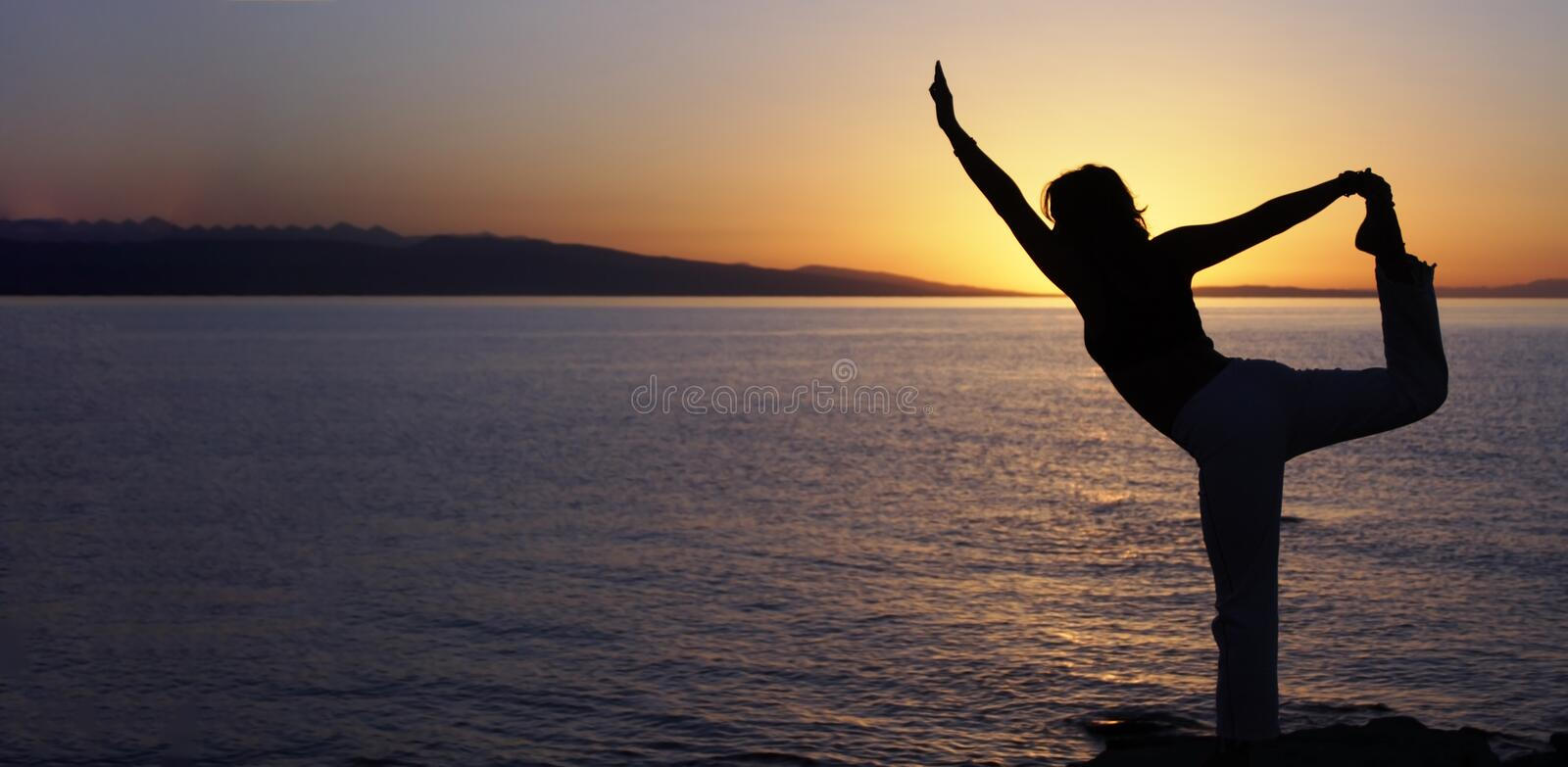Beauty girl on beach in yoga pose, relax silhouette royalty free stock images