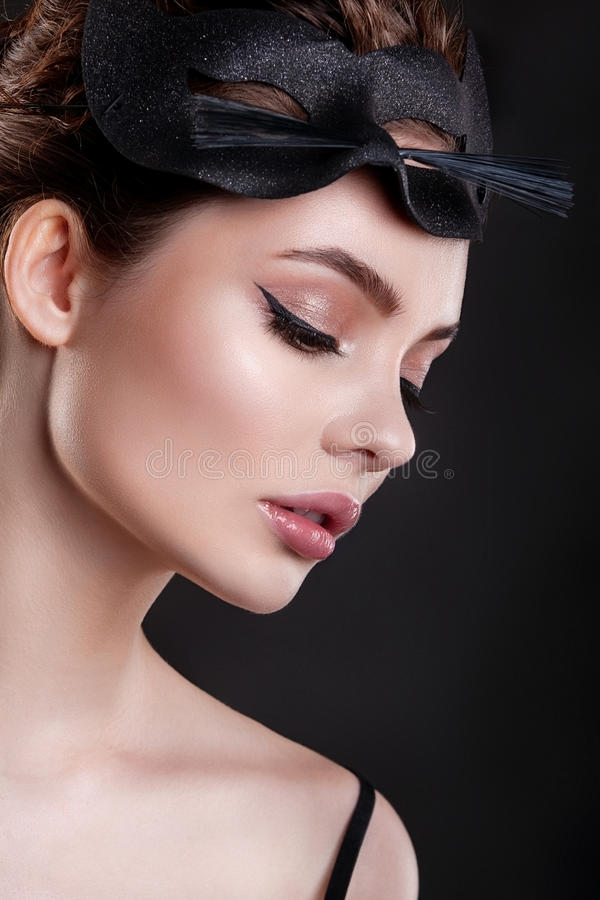 The beauty of the girl . Beautiful woman with mask of cat and professional makeup. stock photos