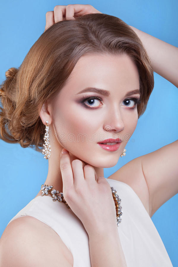 The beauty of the girl . Beautiful woman with professional makeup. stock photography