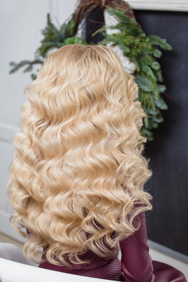 Girl with blonde curly Healthy Wavy hair. Back view. Beauty girl with blonde curly Healthy Wavy hair. Back view stock image