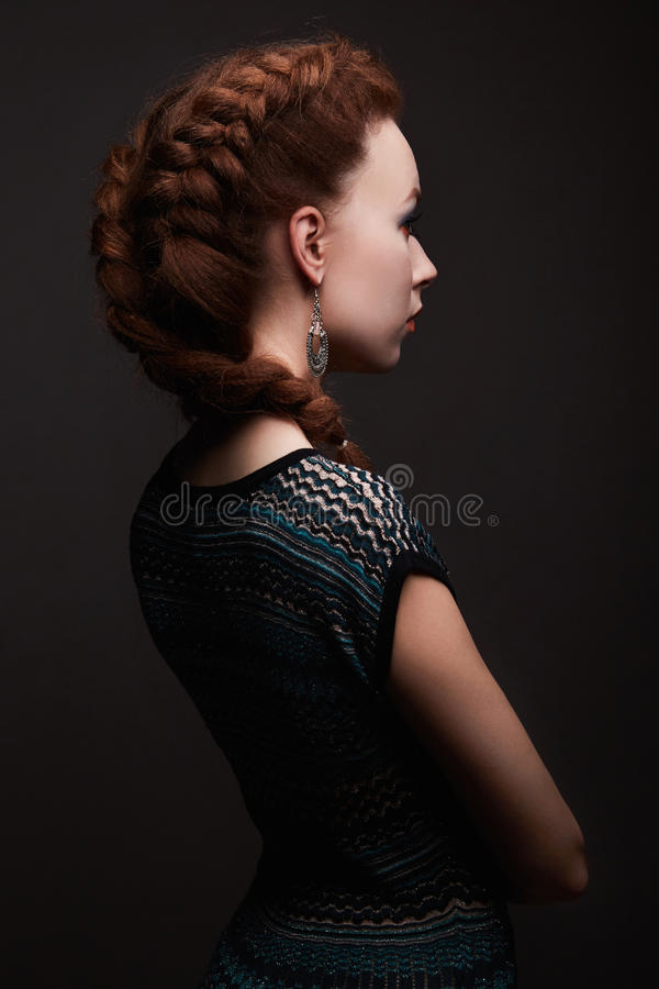 Beauty girl with braids hairstyle. Beautiful young woman royalty free stock photo