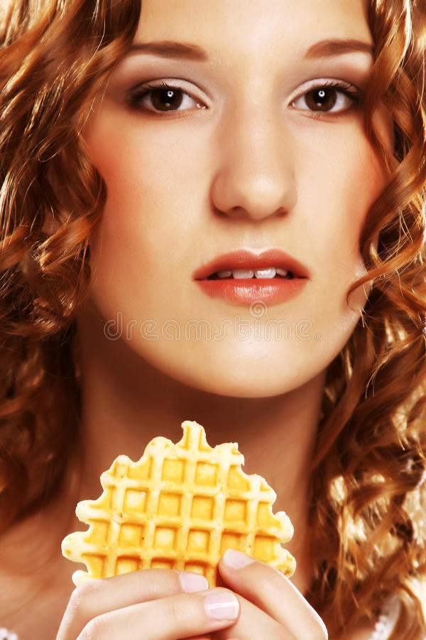 Beauty girl with cookie stock image