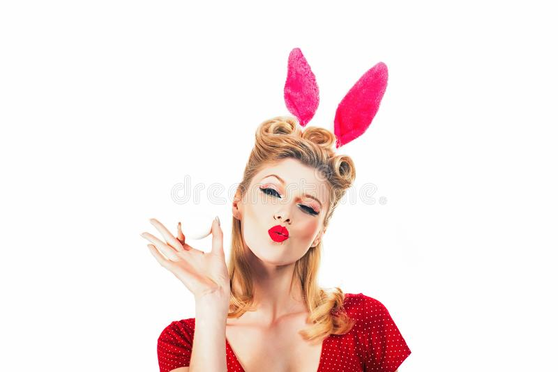 Beauty girl. Easter egg hunting - Easter day concept. Isolated white background. Pin up Easter. Bunny ears concept. Woman wearing a mask Easter bunny and looks royalty free stock photo