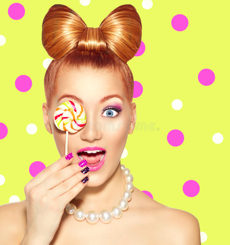 Beauty girl Eating colourful lollipop. Beauty fashion model girl Eating colourful lollipop stock photography