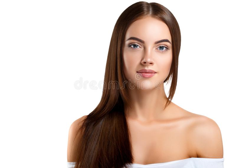 Beauty Girl face Portrait. Beautiful Spa model Woman with Perfect Healthy Hair Smooth. Brunette female looking at camera and. Smiling. Youth and Skin Care royalty free stock photo