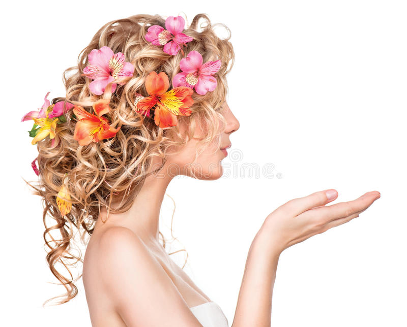 Beauty girl with flowers hairstyle stock images