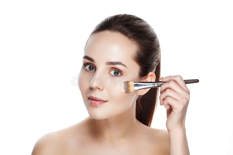 Beauty Girl with Makeup Brushes. Natural Makeup for Brunette Woman with blue Eyes. Beautiful Face. Makeover. Perfect Skin. royalty free stock photography