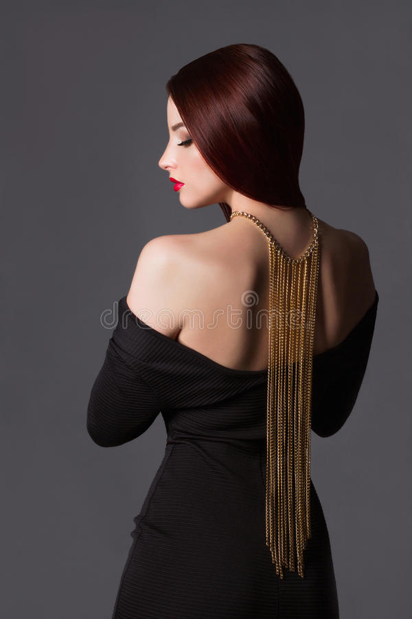 Beauty Girl with a necklace on her back stock image