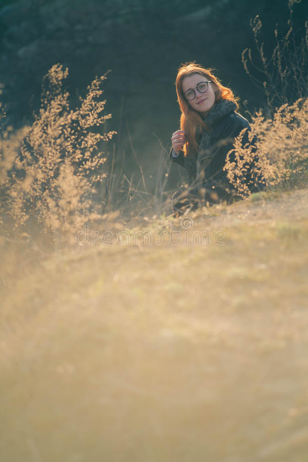 Beauty Girl Outdoors enjoying nature. Beautiful Teenage Model girl with long healthy blowing hair running on the Spring Field, Sun stock image