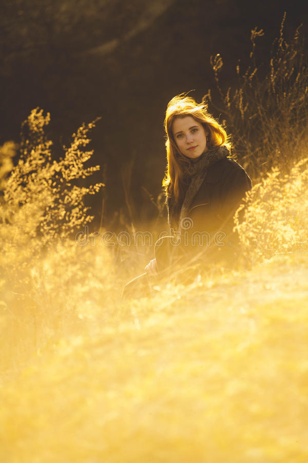 Beauty Girl Outdoors enjoying nature. Beautiful Teenage Model girl with long healthy blowing hair running on the Spring Field, Sun stock images