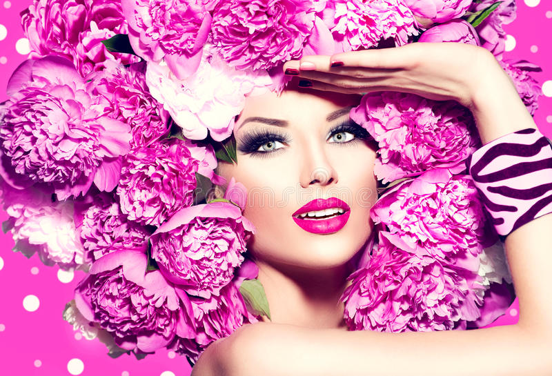 Beauty girl with pink peony hairstyle royalty free stock image
