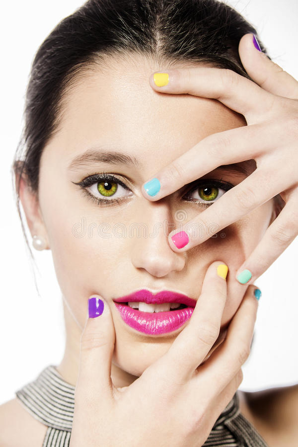 Beauty Girl Portrait with fuchsia lips and colorful Nail polish royalty free stock photos