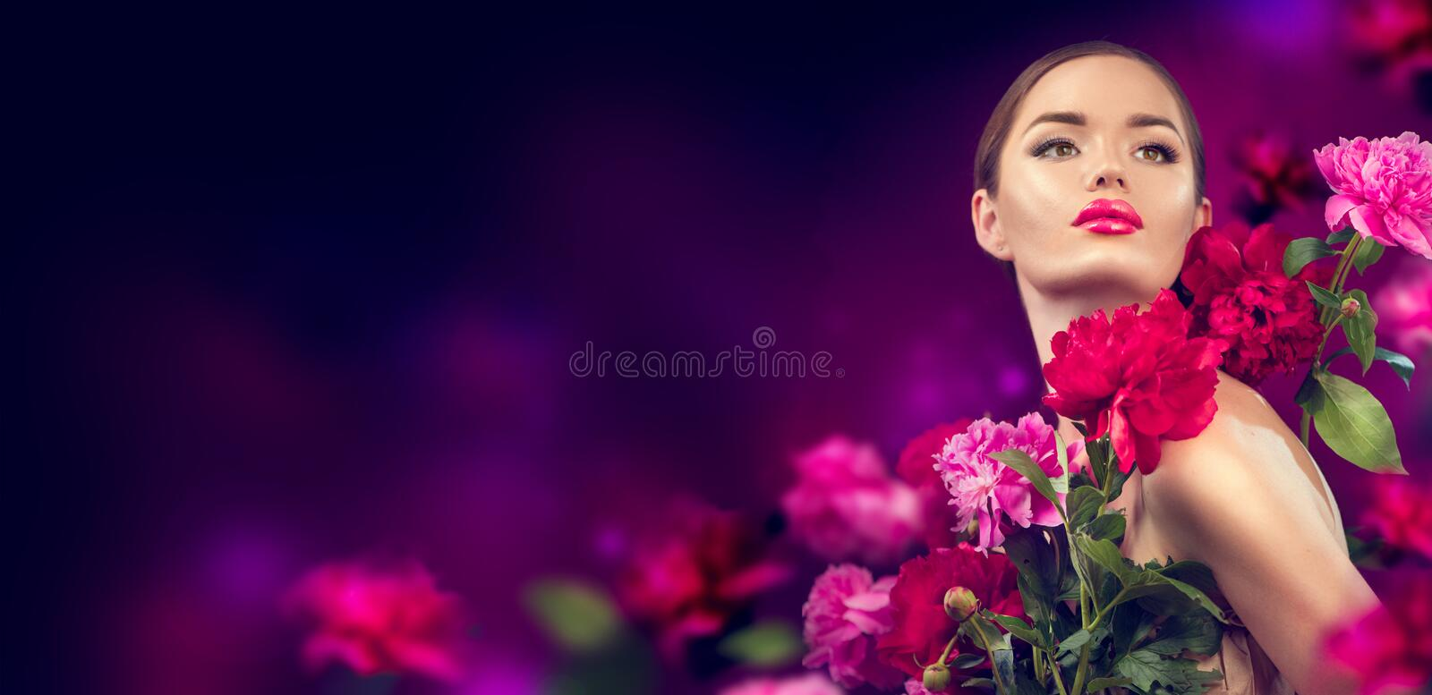 Beauty girl with purple, red, pink peony flowers portrait. Beauty high fashion model woman with peony flowers. Closeup royalty free stock photo
