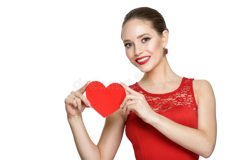 Beauty girl with a red paper heart, isolated on a white background royalty free stock photo