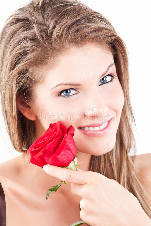 Beauty girl with red rose royalty free stock photography