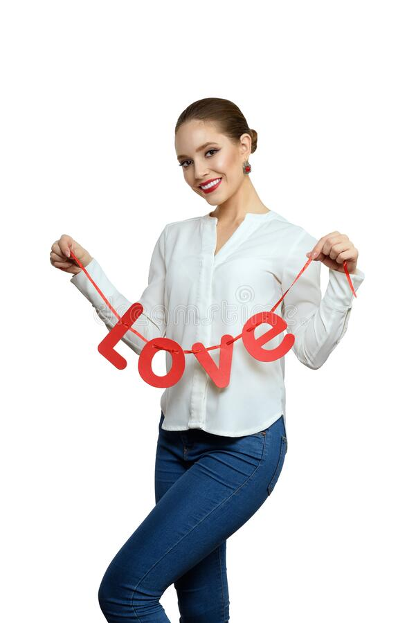 Beauty girl with a red text in shape love, isolated on a white background royalty free stock images
