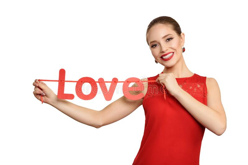 Beauty girl with a red text in shape love, isolated on a white background stock photo