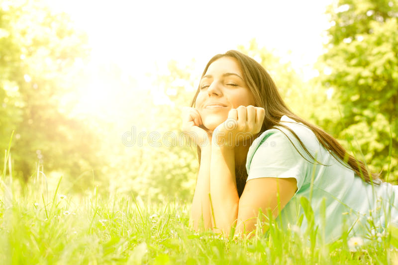 Beauty girl relaxing in nature. Portrait of beauty girl relaxing in nature stock images