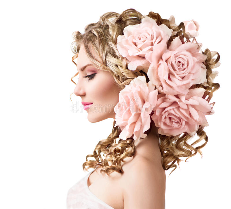 Beauty girl with rose flowers hairstyle. Isolated on white stock photos
