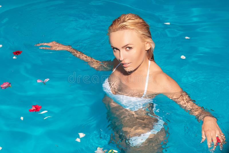 Beauty girl Swimming Pool Concept. Vacation at Paradise. Summer vacation and travel to ocean. Beach Clubs in Ibiza. Happy sea lifestyle. Swimming pool royalty free stock photography