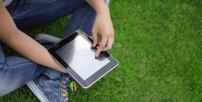 Beauty girl with tablet PC outdoors royalty free stock photo