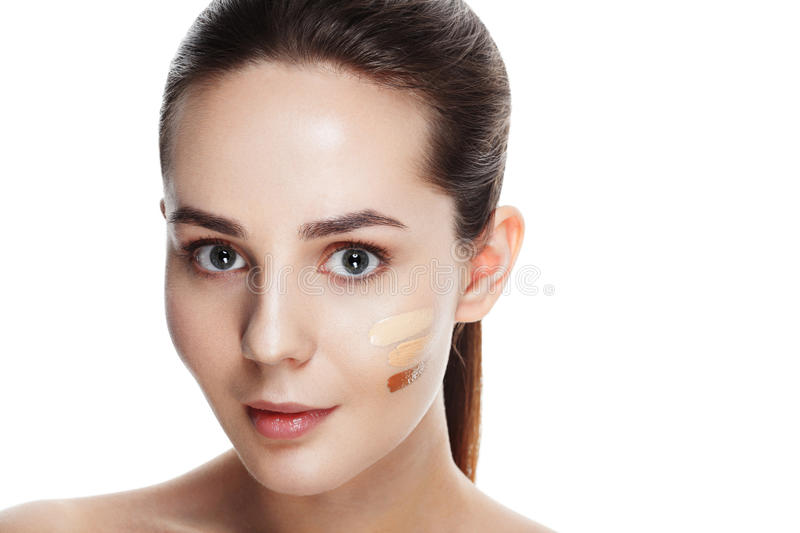 Beauty Girl Try to Different tones of Foundation Concealer. Natural Makeup for Brunette Woman with Beautiful Face. Makeover. Per. Fect Skin. Applying Make-up royalty free stock photography