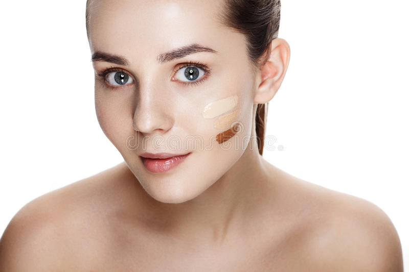 Beauty Girl Try to Different tones of Foundation Concealer. Natural Makeup for Brunette Woman with Beautiful Face. Makeover. Per. Fect Skin. Applying Make-up royalty free stock photo