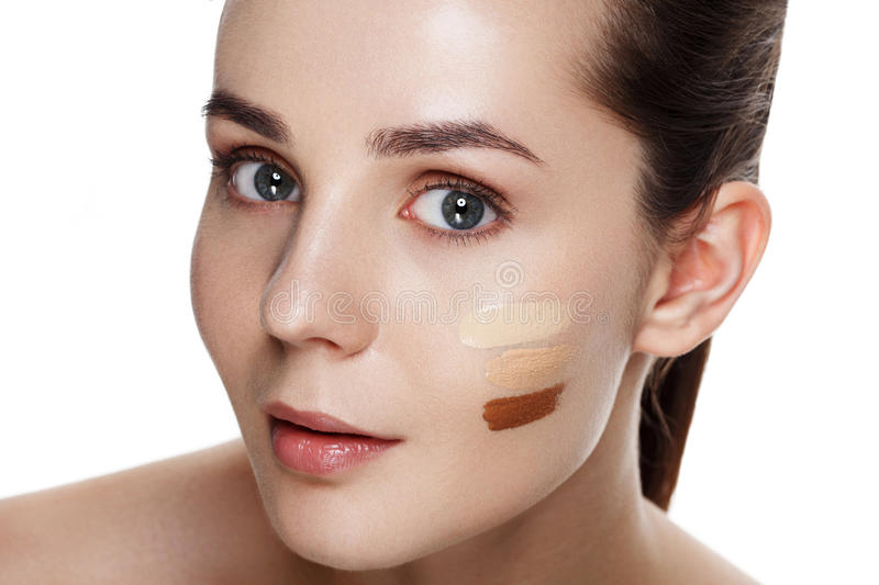 Beauty Girl Try to Different tones of Foundation Concealer. Natural Makeup for Brunette Woman with Beautiful Face. Makeover. Per royalty free stock image