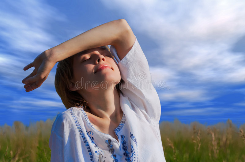 Beauty girl under clouds stock images