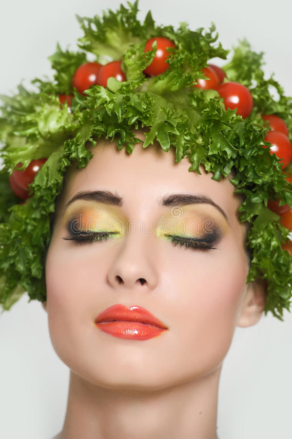 Beauty girl with Vegetables hair style. Beautiful happy young woman with vegetables on her head. Healthy food concept, diet, veget stock images