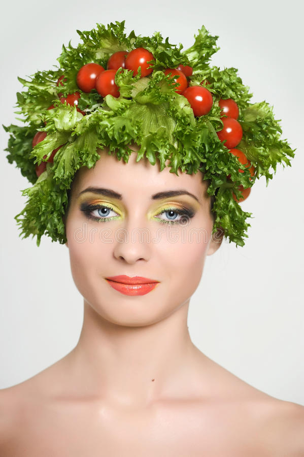 Beauty girl with Vegetables hair style. Beautiful happy young woman with vegetables on her head. Healthy food concept, diet, veget royalty free stock photos