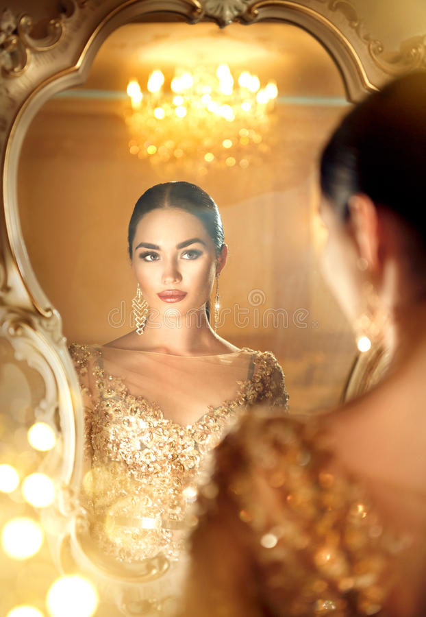 Beauty glamour lady looking in the mirror royalty free stock photos