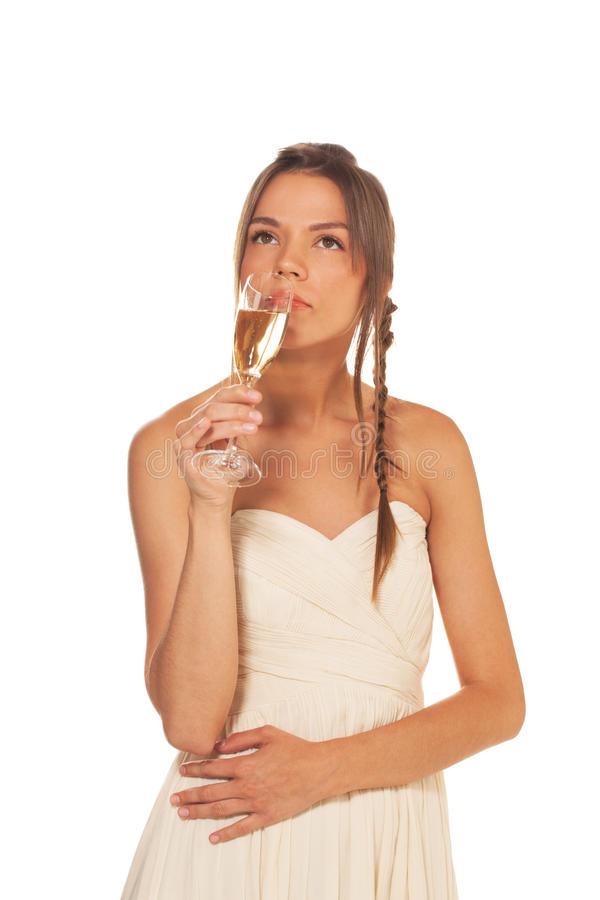 Beauty with glass of champagne. Young beauty with glass of champagne on isolated white background royalty free stock photos