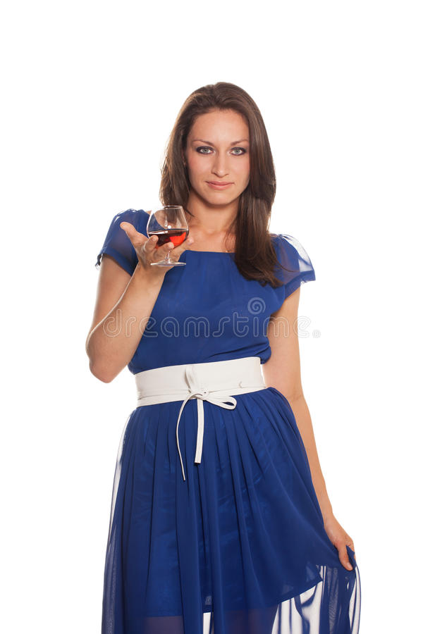 Beauty with glass of cognac royalty free stock images