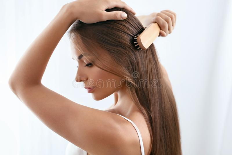Beauty Hair Care. Beautiful Woman Brushing Long Healthy Hair. With Hairbrush. High Resolution royalty free stock images