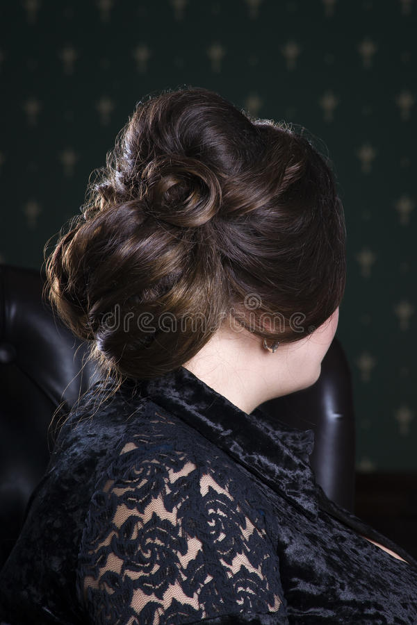Beauty hairstyle, brunette woman with hair styling royalty free stock photography