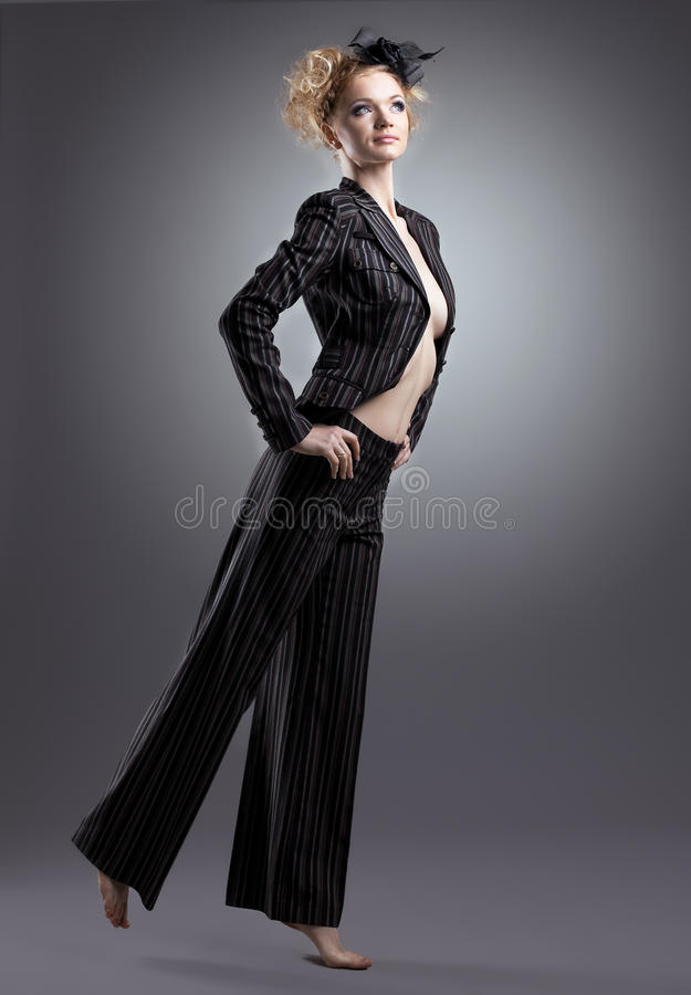 Beauty half-naked woman posing in black costume stock image