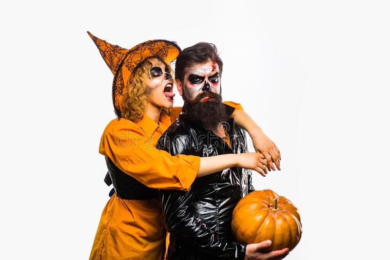 Beauty Halloween girl and Handsome bearded man hold pumpkin on isolated background. Halloween Party people. royalty free stock photography